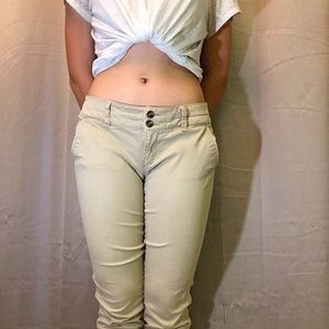 Tan double button American eagle skinny jeans